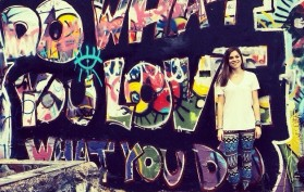 """""""Do what you love, love what you do"""" Jenna stitches at the graffiti wall in Austin, TX."""